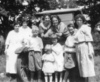 Marie A (Mae) Ritter center left on car - Anna Kinzler center right